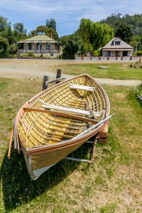 old rowing boat infront of colonial cottages Huonville