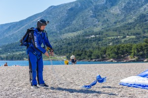Brac, Croatia - May 07, 2016: parachutist landing on Zlatni Rat beach, Croatia