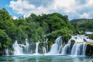 Krka national park, Croatia - May 05, 2016: waterfall and rock pool